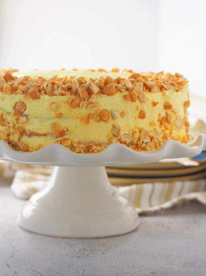 sans rival cake with chopped cashews on a cake platter