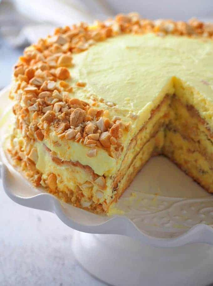 cut Filipino Sans Rival cake on a cake platter stand