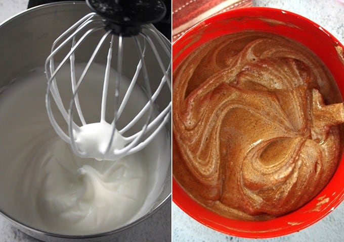 whipped eggs in a stand mixer and folded in the chocolate mixture in a red bowl