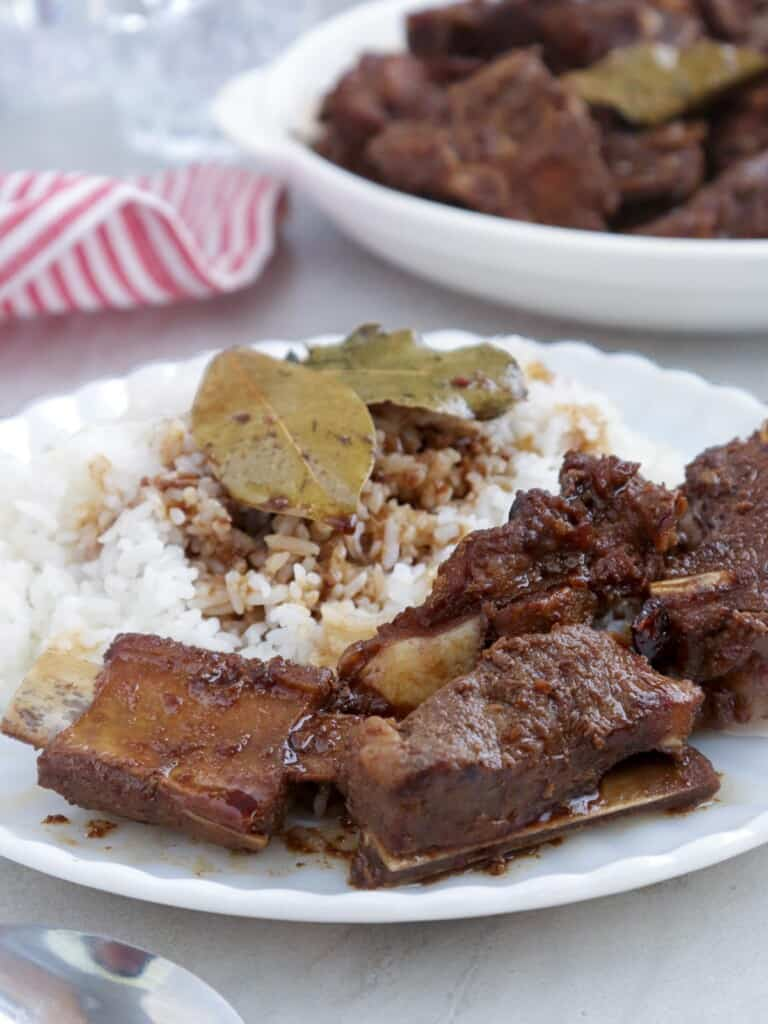 Chinese-style Pork Asado over rice on a white plate