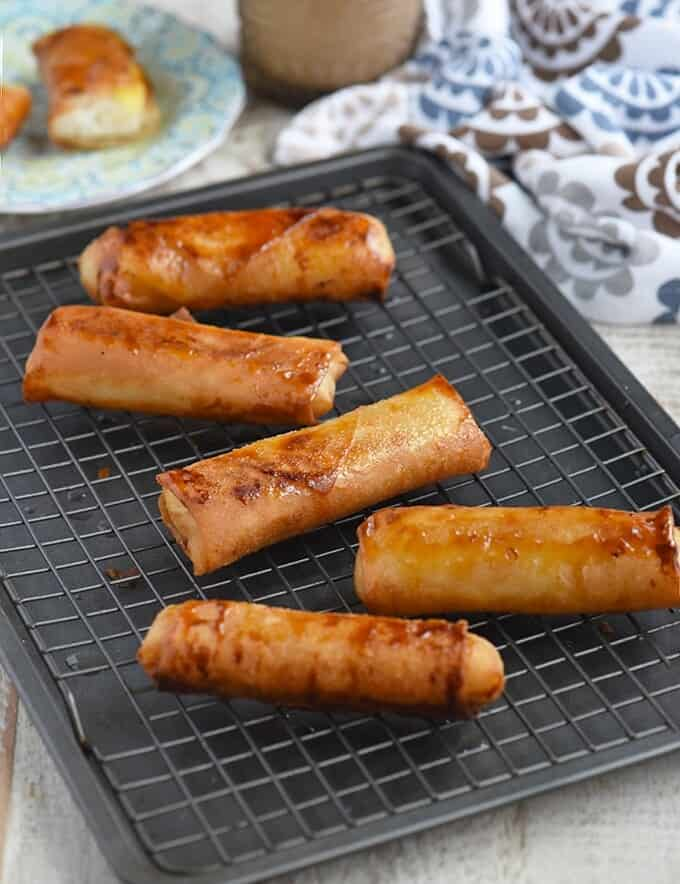 fried turon malagkit on a baking sheet fitted with a wire rack