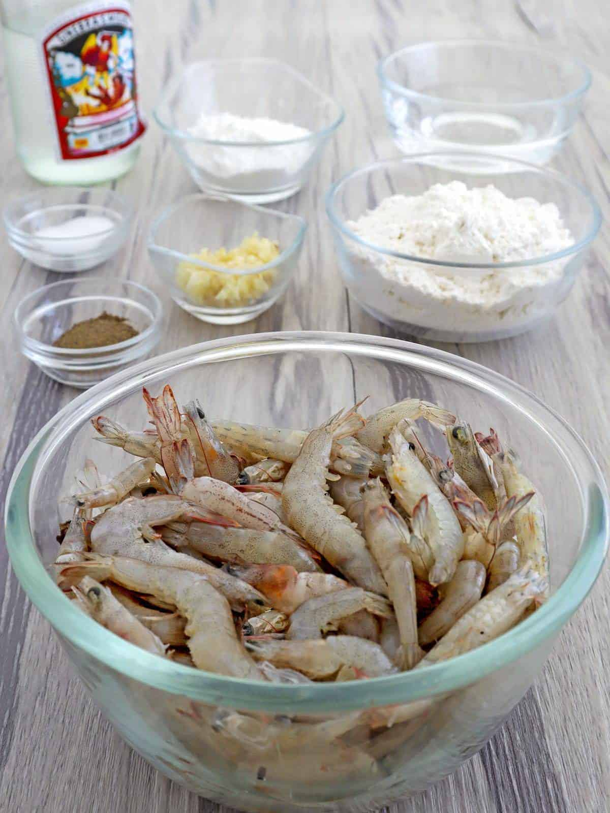 shell-on shrimp, flour, cornstarch, minced garlic, salt, pepper, gin