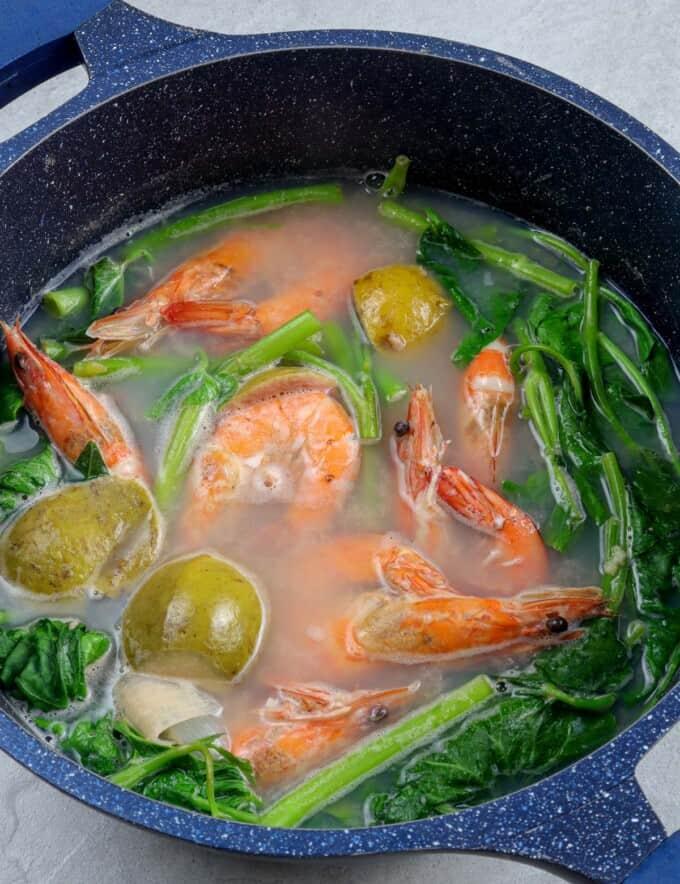 sinigang na hipon sa bayabas in a pot