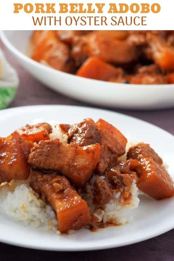 Pork Adobo with Oyster Sauce on a serving platter with a plate of steamed rice on the side
