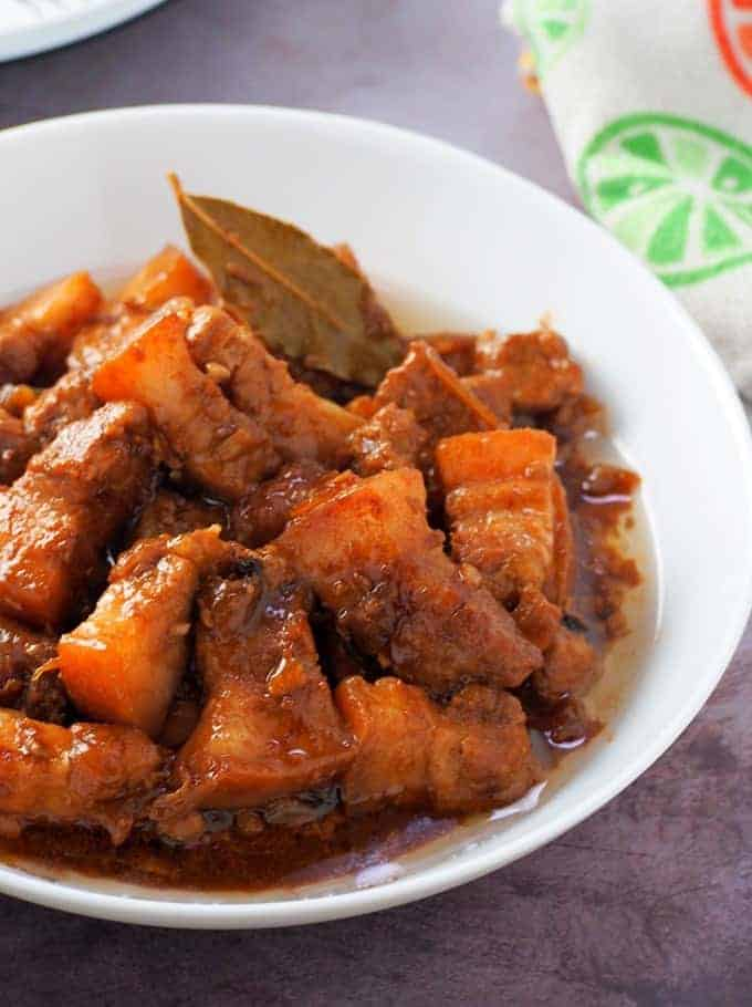 Adobong Baboy with Oyster Sauce in a white serving bowl