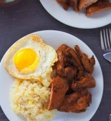 top view of chicken tapsilog on a white serving plate