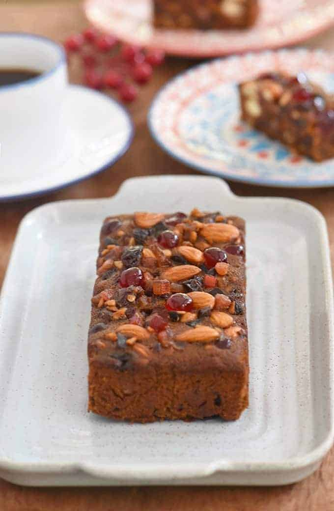 Holiday fruitcake with glazed fruits and nuts on a serving platter