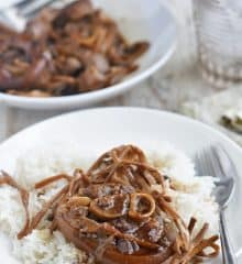 patang paksiw over steamed rice on a white plate