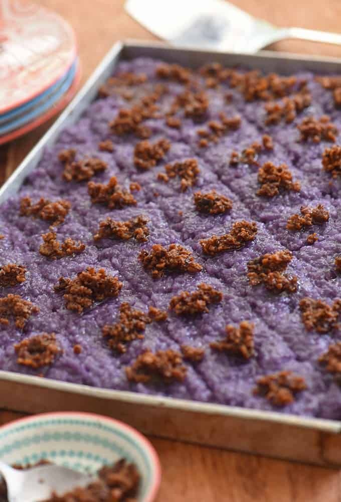 Ube Biko in an aluminum tray with latik topping