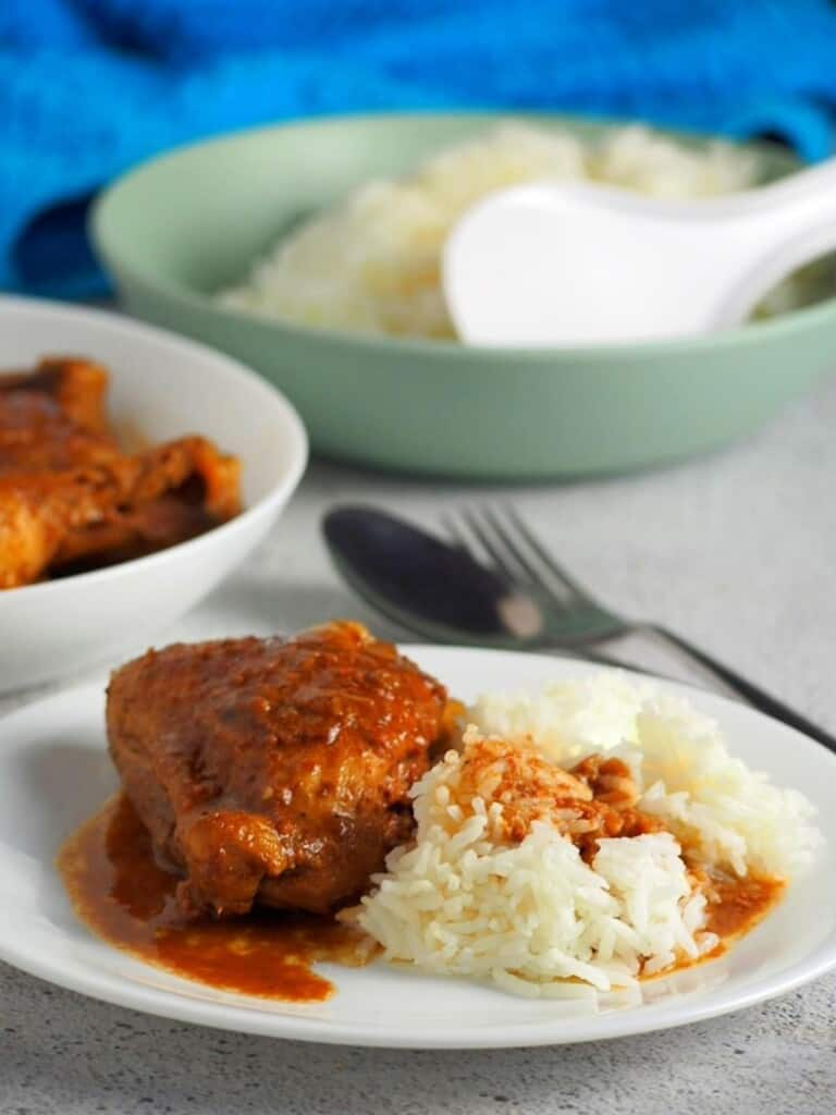 adobong manok with liver spread on a plate with steamed rice