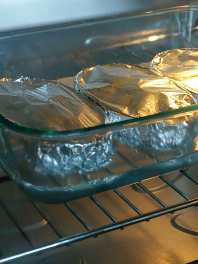 cooking caramel custard in a bain marie in the oven