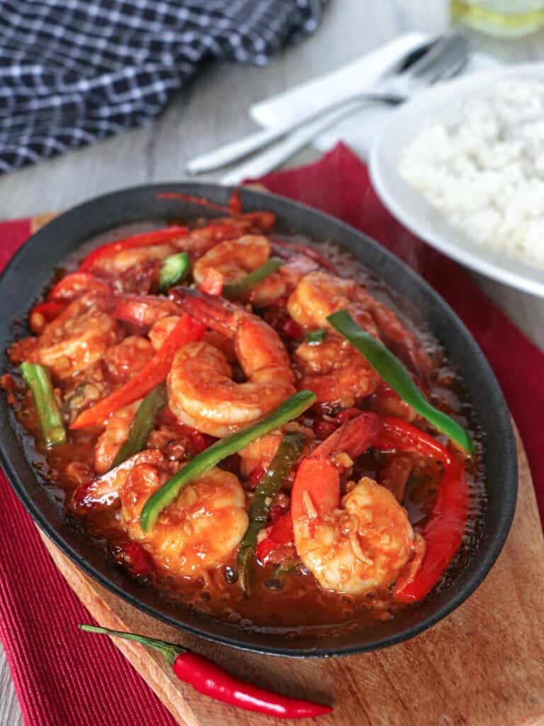 sizzling gambas on a cast iron skillet