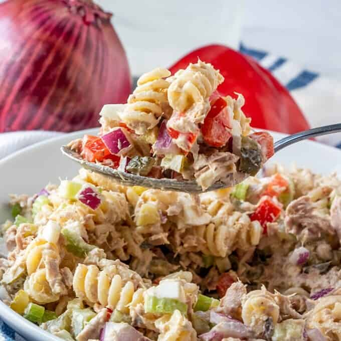 serving pasta salad with tuna with a fork