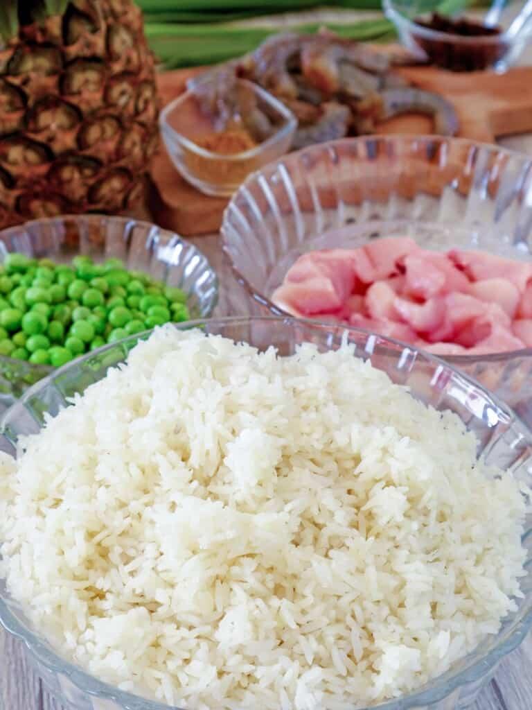 steamed rice, chicken, shrimp, green peas, pineapple