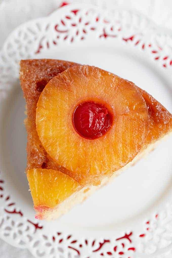 slice of pineapple upside-down cake on a white plate