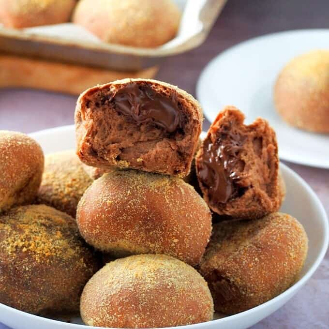chocolate pandesal on a white plate