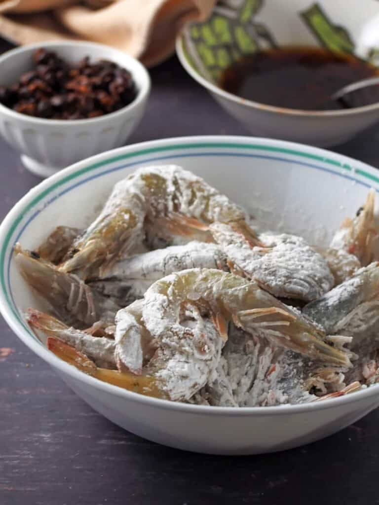 shrimp coated with cornstarch in a bowl