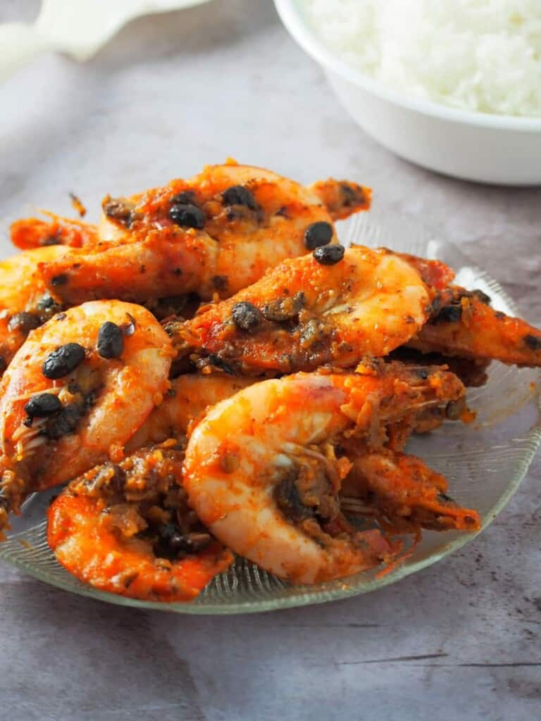 Shrimp in Black Bean Sauce on a serving plate with a bowl of steamed rice on the side