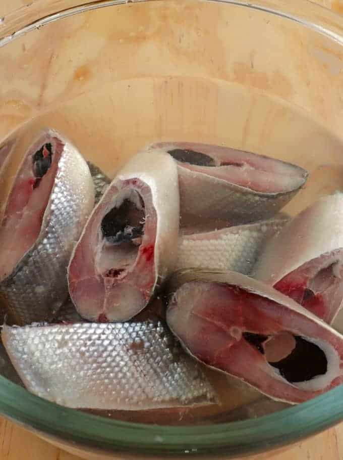 sliced milkfish in a brine solution