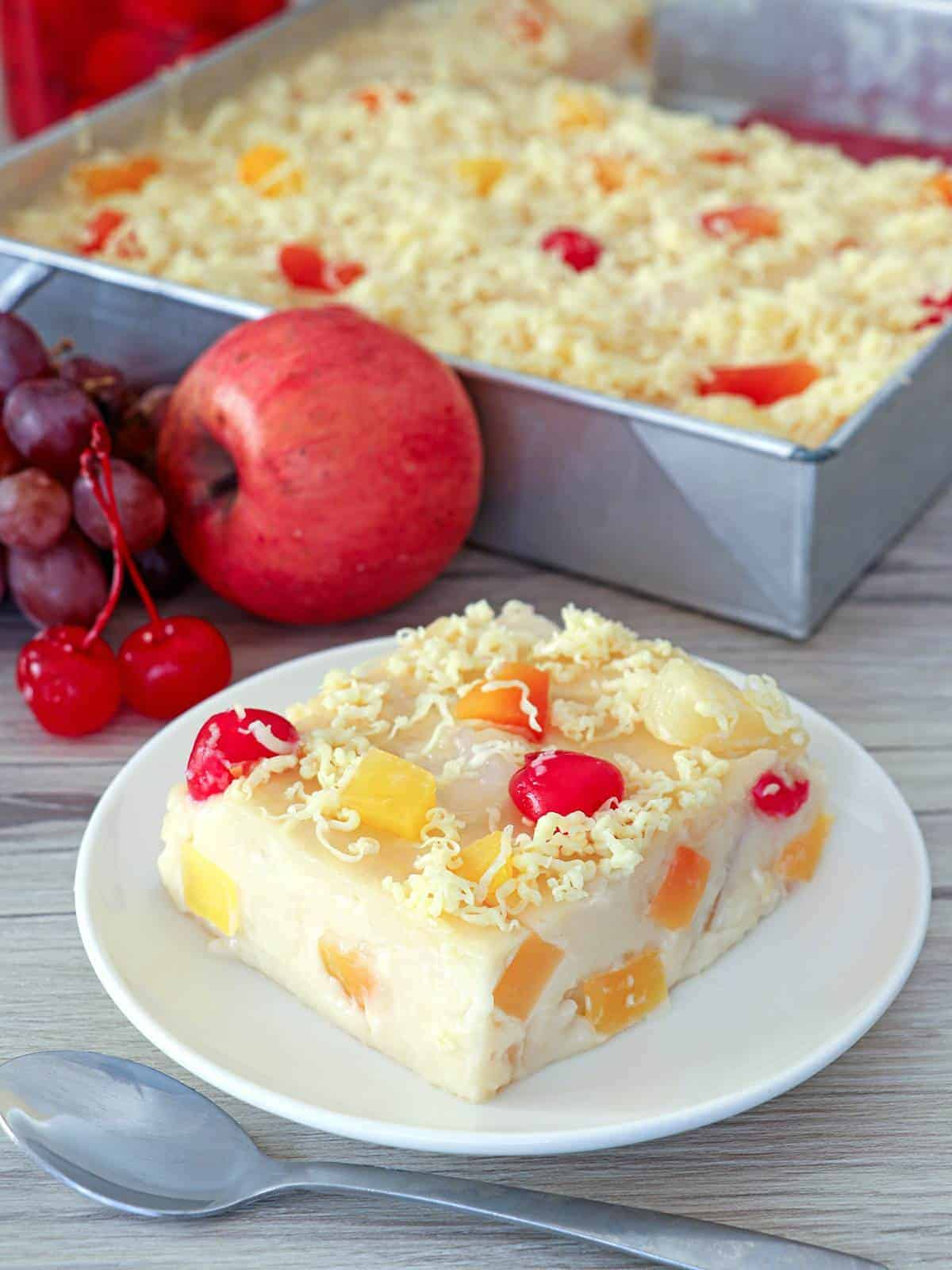 slice of fruity maja blanca on a white serving plate