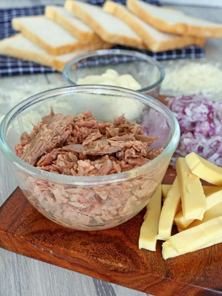 canned tuna, sliced cheese, chopped red onions, mayonnaise, sliced bread, sweet relish