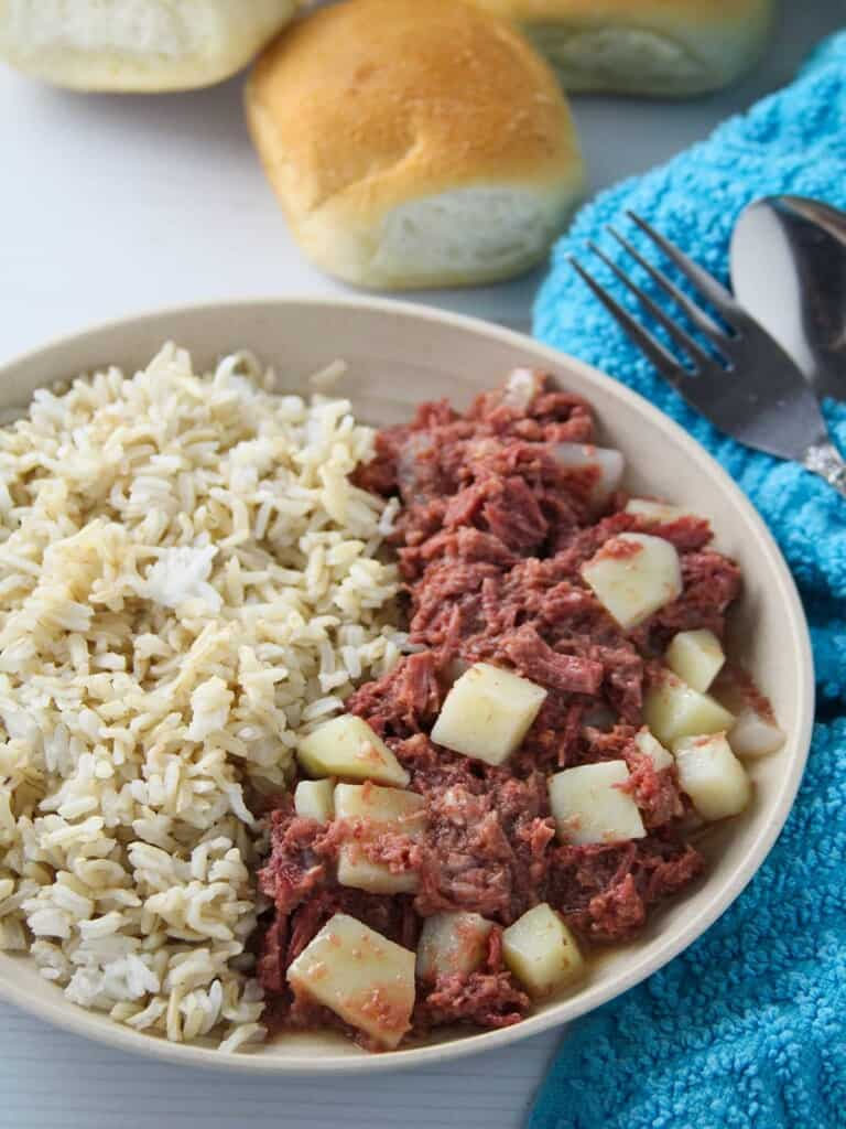 corned beef guisado with steamed rice on a serving plate