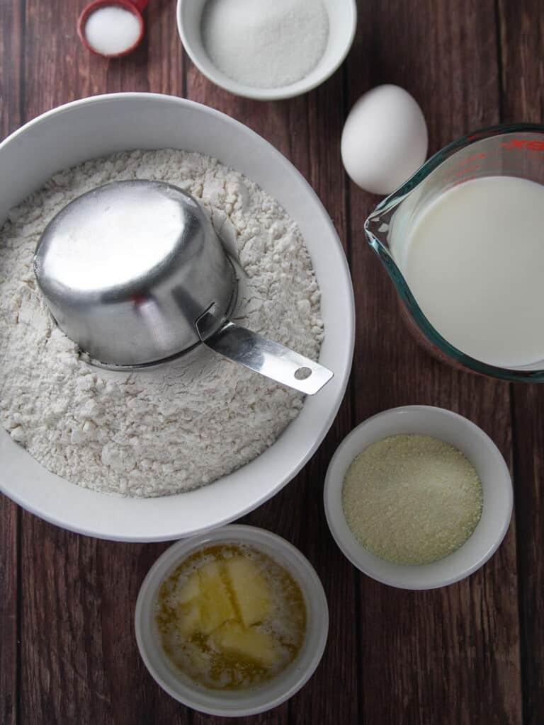 flour, eggs, milk, butter, yeast, milk powder, sugar, salt