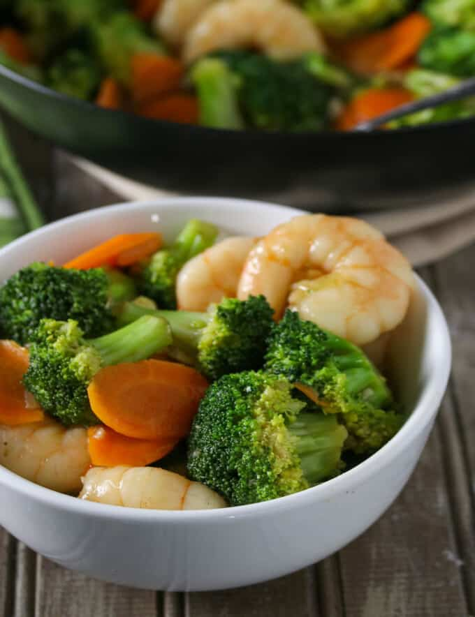 broccoli and shrimp stir-fry in a white bowl