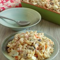 serving chicken macaroni salad with a large spoon