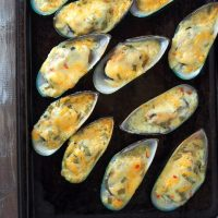baked tahong with sweet chili-mayo topping on a baking sheet