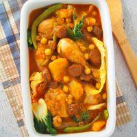 top view of Chicken Pochero in a rectangular serving casserole